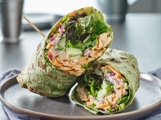 healthy green lettuce and chicken salad wrap