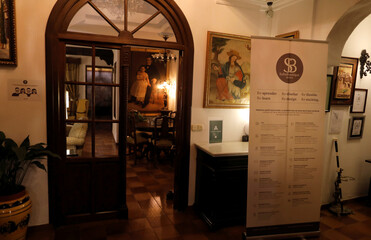 An informative banner for guests with health and safety measures is seen at the lobby of the Soho Boutique Palacio San Gabriel hotel after an easing of restrictions imposed to control the spread of the coronavirus disease (COVID-19), in downtown Ronda