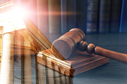 Law protection. Double exposure of wooden gavel and court building
