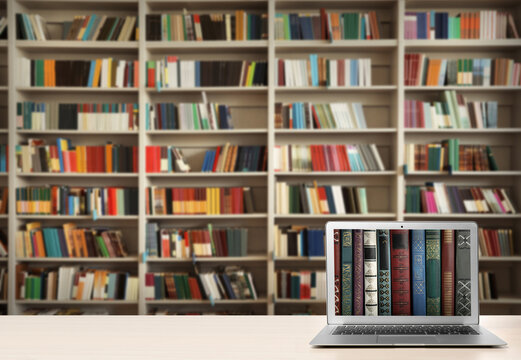 Digital library concept. Modern laptop on table indoors, space for text