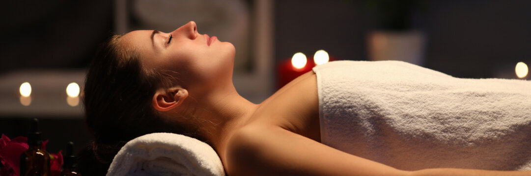 Girl preparing for spa treatments in fashion salon. Effective and enjoyable way to take care your health. Restore harmony and balance psycho-emotional state. Wellness stress relief
