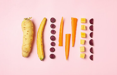 Fototapete - Whole and cut raw color carrots on pink background, flat lay