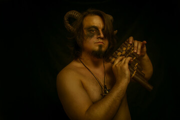 Faun with panflute