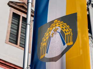 Flag of Mariazell in front Basilica of the Birth of the Virgin Mary