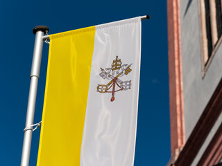 Flag of Vatican in front Basilica of the Birth of the Virgin Mary in Mariazell