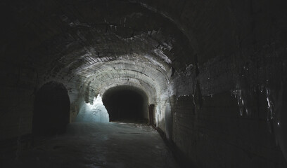 Papiers peints Tunnel Old dark tunnel of an abandoned bomb shelter, panorama.