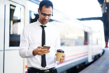 Man in suit browsing phone