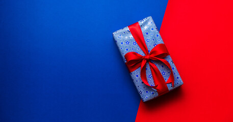 gift box with red ribbon in blue background