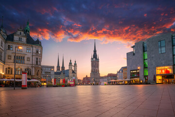 Halle, Germany. Cityscape image of historical downtown of Halle (Saale) with the Red Tower and the Market Place during dramatic sunset.