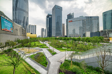 Beautiful green garden among skyscrapers of the Pudong New Area
