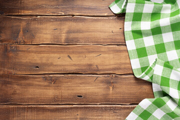 cloth napkin on at rustic wooden plank board table