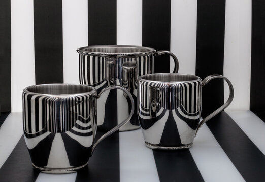 Black and white stripes in cups reflection