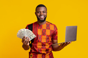 Cheerful african american man making money from internet at home