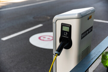 Charging station for electric cars in city. New energy vehicles.