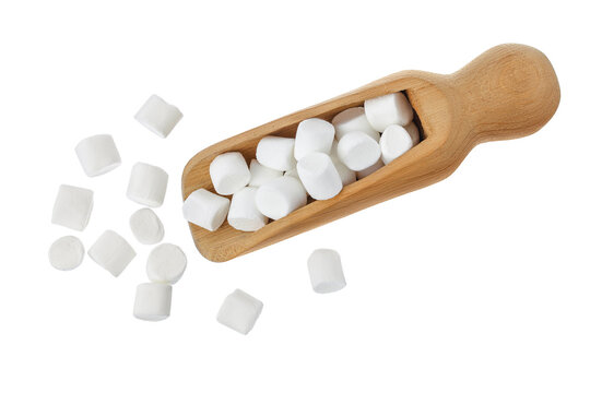 Marshmallow in wooden scoop isolated on white background with clipping path and full depth of field. Top view. Flat lay