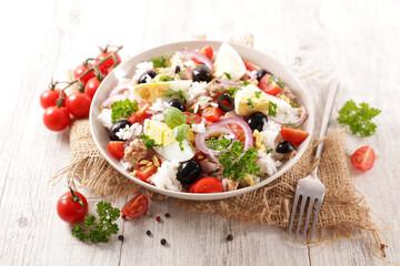 rice salad with olive, egg, tuna and tomato