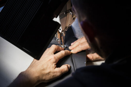 Tailoring of leather products. Repair of the car seat cover.