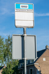 Empty Dutch bus stop sign