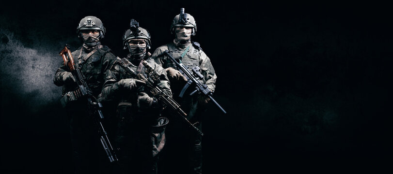 Image of three soldiers in a shooting computer game. ESports concept.