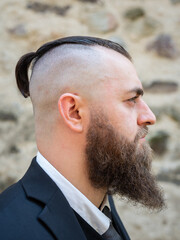 Profile portrait of a man with a long beard