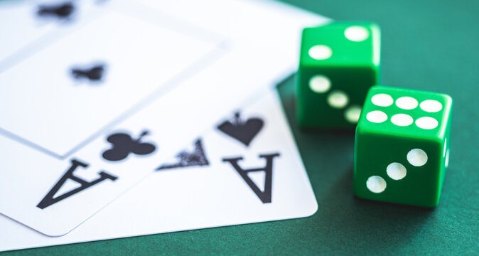 Green dice and playing cards