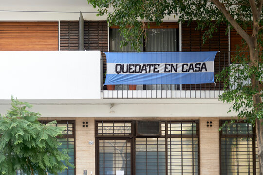 Argentine flag with the message Stay at home, in the context of the pandemic and the quarantine to prevent the spread of coronavirus disease, Covid-19