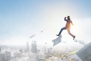 Businessman jumping high in the air