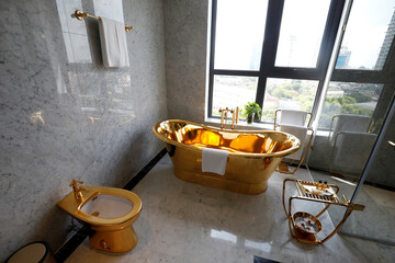 A gold plated bathtub and a gold plated toilet are seen in the newly-inaugurated Dolce Hanoi Golden Lake luxury hotel, after the government eased a nationwide lockdown following the global outbreak of the coronavirus disease (COVID-19), in Hanoi