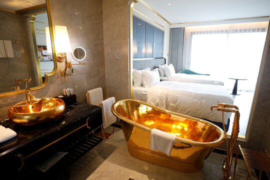 A gold plated bathtub and a gold plated bathroom sink are seen in the newly-inaugurated Dolce Hanoi Golden Lake luxury hotel, after the government eased a nationwide lockdown following the global outbreak of the coronavirus disease (COVID-19), in Hanoi