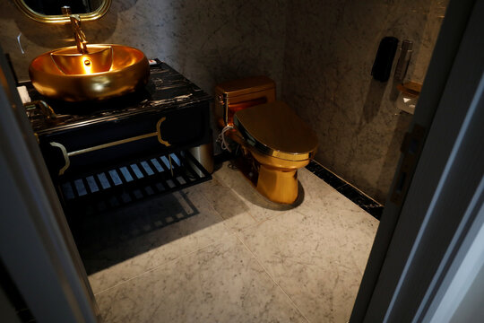 A gold plated bathroom sink and a gold plated toilet are seen in the newly-inaugurated Dolce Hanoi Golden Lake luxury hotel, after the government eased a nationwide lockdown following the global outbreak of the coronavirus disease (COVID-19), in Hanoi
