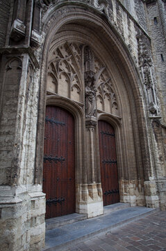 Medieval architecture style of door at St. Bavo's Cathedral in Ghent Belgium