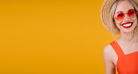 Active Adorable smiling blonde woman portrait on yellow background. Heart shaped fashionable pink sunglasses. Happy summer mood vibes moments. Horizontal long banner. big red lips teeth smile