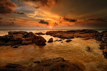 Sri lanka sunset, ocean coast with rocks and sun. Orange evening in the nature. Sri Lanka sea landscape, travelling in Asia.
