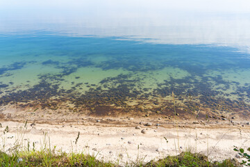 View from the steep coast down to the natural beach of the Baltic Sea at Weissenhäuser Strand, Germany