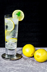 Water with lemon and ice cubes