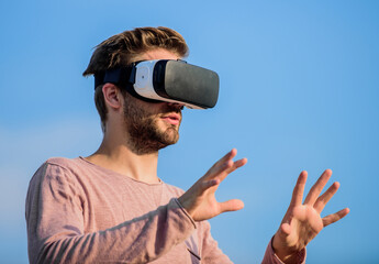 Amazing technology. male reality. Use vr headset. create own business. Digital future and innovation. macho man wear wireless VR glasses.. guy virtual reality. sexy man sky background vr glasses