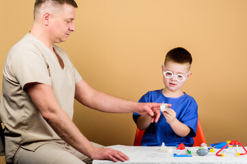 First aid. Medical help. Trauma and injurie. Medicine concept. Kid little doctor sit table medical tools. Health care. Medical examination. Boy cute child and his father doctor. Hospital worker
