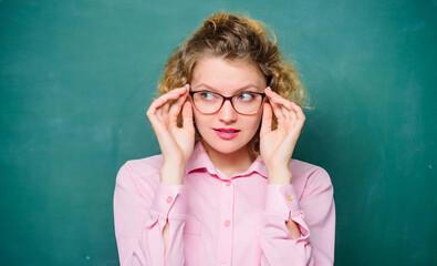 Playful teacher. Woman school teacher shy and pretty lady wear eyeglasses chalkboard background. Adorable nerd. Sexy teacher concept. Smart girl teaching you. Let me see. Attractive educator