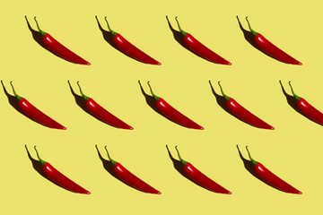 pattern of red chili peppers on a yellow background