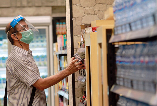 A man wears a face shield and a protective face mask as he shops at a Food Hall Supermarket amid the outbreak of the coronavirus disease (COVID-19) in Jakarta