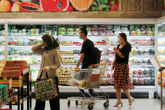 People are wearing protective face masks as they shop at a Food Hall Supermarket amid the outbreak of the coronavirus disease (COVID-19) in Jakarta
