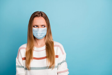 Close-up portrait of her she nice attractive irritated annoyed unhealthy sick ill girl wearing safety gauze mask mers cov influenza symptom isolated bright vivid shine vibrant blue color background