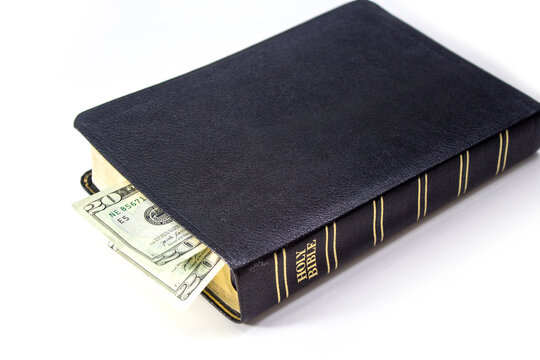 Holy Christian Bible with Money Isolated on White