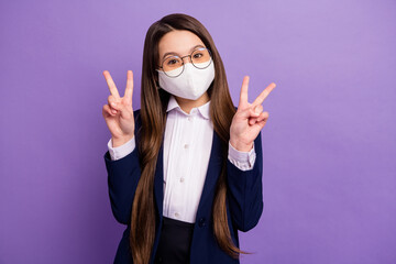 Portrait of her she nice healthy small little long-haired girl wearing reusable safety mask showing...