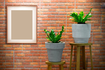 Photo frame mockup hanging on brick wall decorated with house plant.