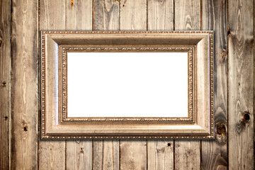Photo frame mockup on wooden wall.