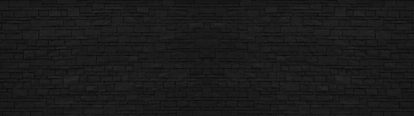 Dark black painted brick natural stone masonry wall texture background wallpaper panorama banner