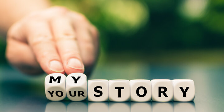 """Hand turns dice and changes the expression """"your story"""" to """"my story""""."""