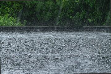 Obraz Heavy rain on a black flat roof - fototapety do salonu