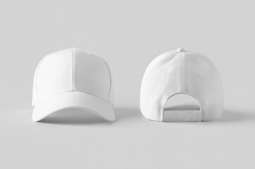 White baseball caps mockup on a grey background, front and back side.